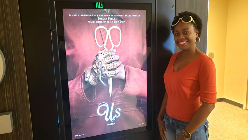 "Movie ""US"" poster with Debi"